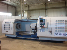MODERN  TOOL  Hollow  Spindle-Heavy  Duty  CNC  Lathe, ModelTNC-1060x3000, 9  inch  Spindle  Bore, 42  inch  Swing  x  120  inc  centers